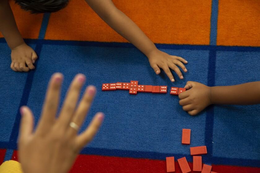 Children playing math games at Esperanza Elementary School in Los Angeles