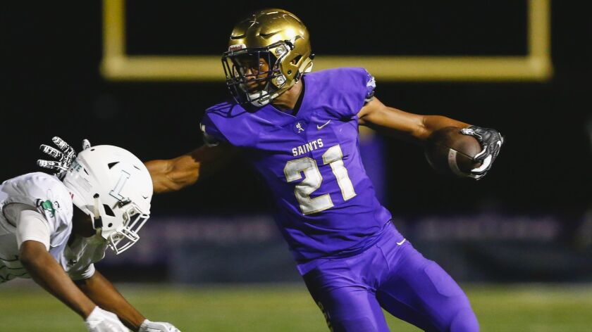 St. Augustine running back Byron Cardwell (21) rushes during the third quarter against Lincoln.