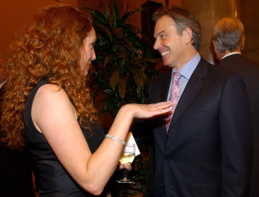 Former British Prime Minister Tony Blair with Rebekah Brooks, ex-chief executive of News International and a defendant in a phone hacking trial.