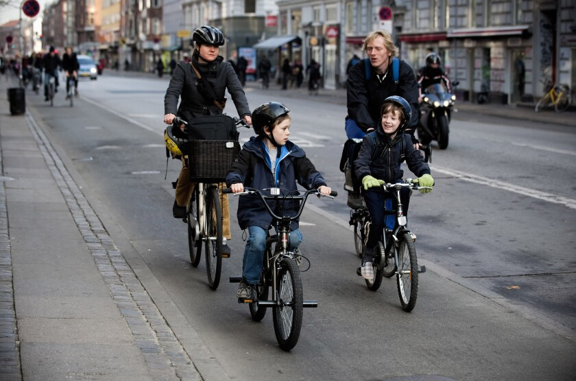 A Danish family rides along a bicycle path in central Copenhagen in 2009.