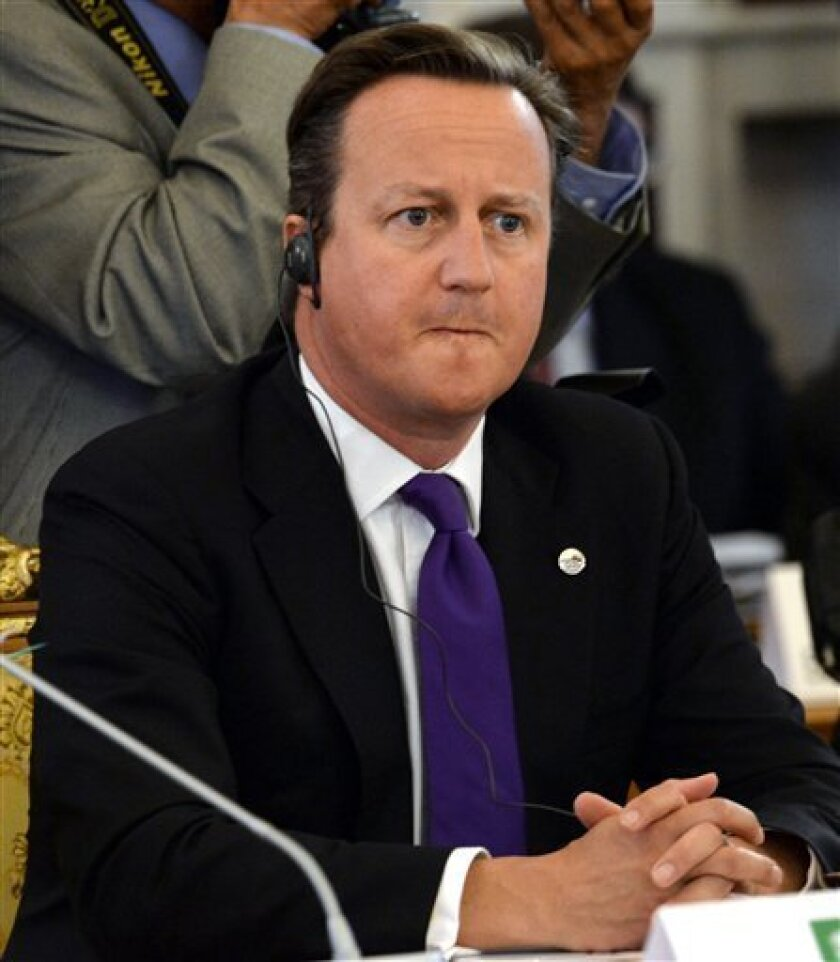 Britain's Prime Minister David Cameron listens to comments during a working session at a G-20 summit in St. Petersburg, Russia on Friday, Sept. 6, 2013. World leaders are discussing Syria's civil war at the summit but look no closer to agreeing on international military intervention to stop it. (AP Photo/Dimitar Dilkoff, Pool)
