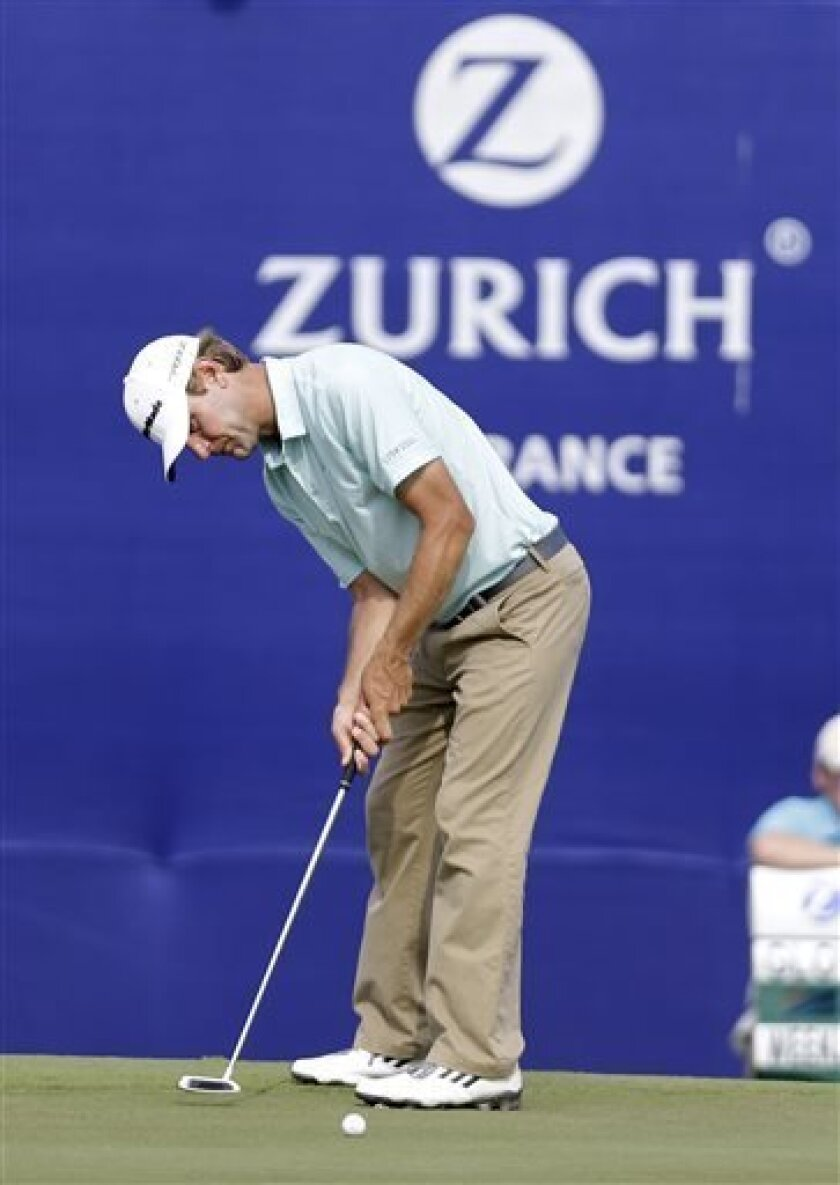 Lucas Glover putts on the 18th green during the third round of the PGA Zurich Classic golf tournament at TPC Louisiana in Avondale, La., Saturday, April 27, 2013. (AP Photo/Gerald Herbert)