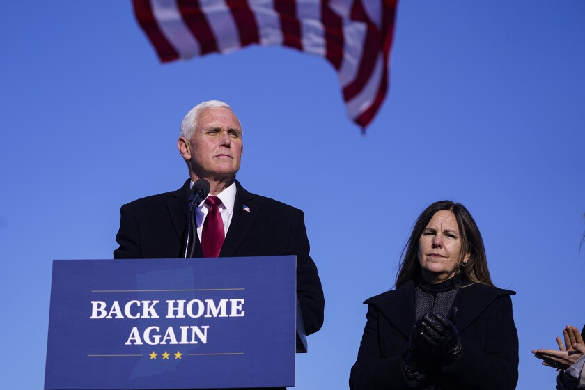Former Vice President Mike Pence speaks after arriving back in his hometown of Columbus, Ind., Wednesday, Jan. 20, 2021. Pence has returned to his Indiana hometown, where he told a small crowd that serving in the White House was the greatest honor of his life. Pence flew on a government plane Wednesday afternoon into the Columbus Municipal Airport with his wife, Karen, after attending President Joe Biden's inauguration. (AP Photo/Michael Conroy)