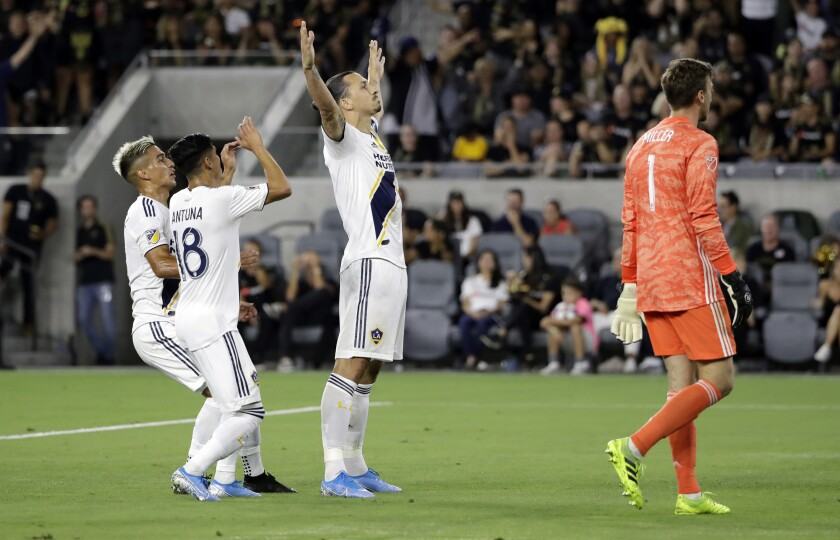 Zlatan Ibrahimovic, center, celebrates with teammates after scoring against LAFC during the first half Sunday.
