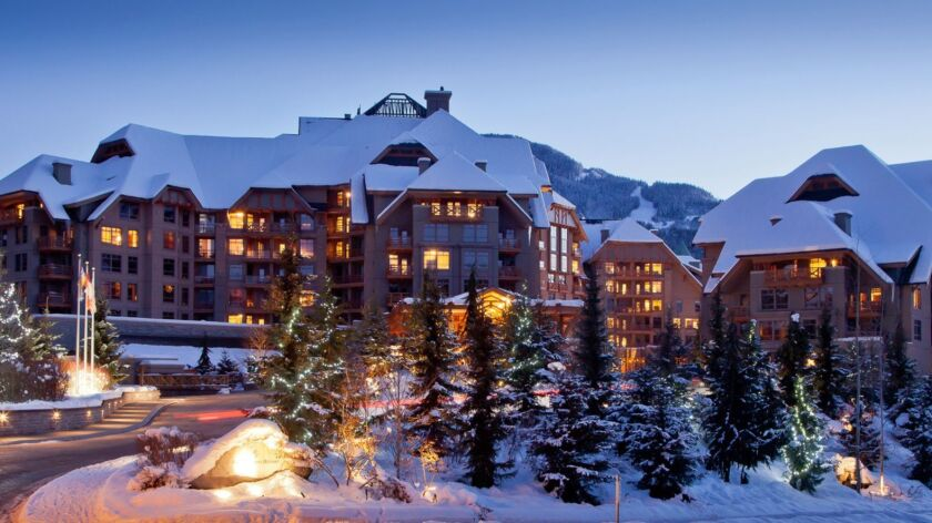 The Four Seasons rustic modern retreat beckons guests with mountain views and alpine allure. The Fo
