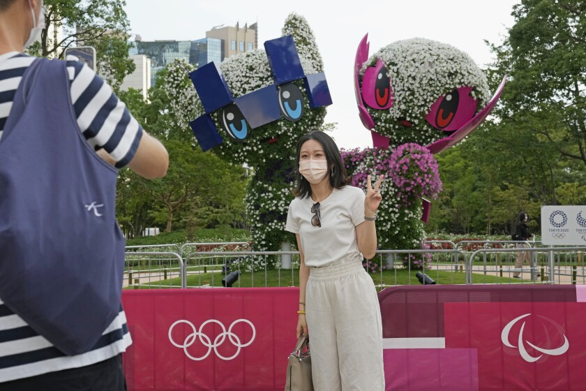 A couple take a photo at Symbol Promenade Park in July.