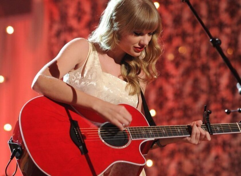 """Taylor Swift's new album, """"Red,"""" posted strong sales on its first day of release."""
