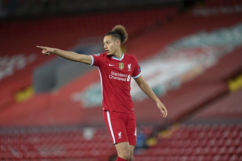Liverpool's Rhys Williams points after coming on as a substitute for the injured Fabinho during the Champions League Group D soccer match between Liverpool and FC Midtjylland at Anfield stadium, in Liverpool, England, Tuesday, Oct. 27, 2020. (Michael Regan/Pool via AP)