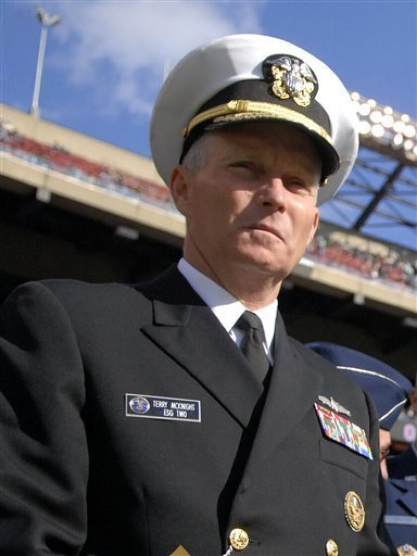 In this image provided by the US Navy, Rear Adm. Terence E. McKnight, stands on the sidelines at the Meadowlands before the NFL game between the New York Jets and St. Louis Rams on Military Appreciation Day Nov. 9, 2008. The announcement Thursday Jan. 8, 2009 by U.S. Navy officials in Bahrain did n