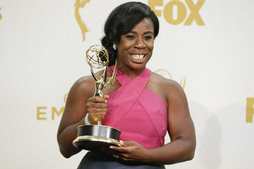 """Uzo Aduba holds her supporting actress in a drama series Emmy for her performance in """"Orange Is the New Black"""""""