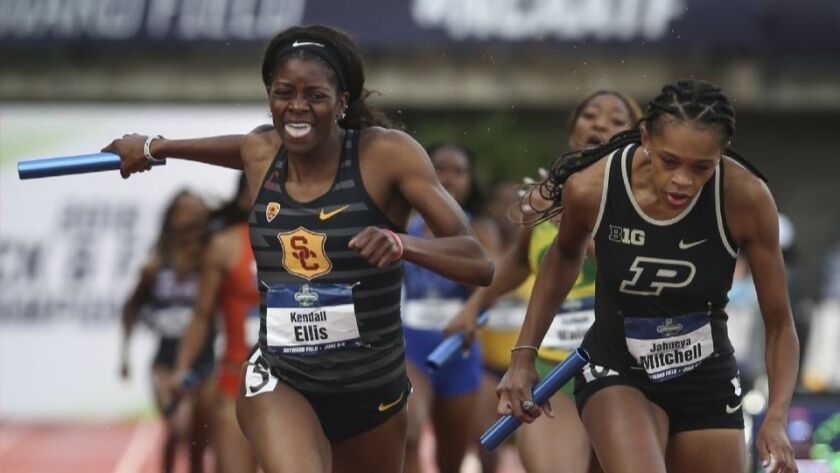 USC's Kendall Ellis crosses the finish line first ahead of Purdue's Jaheya Mitchel in the women's 1,600-meter relay, delivering an incredible comeback for the Trojans' relay team at the 2018 NCAA championships.