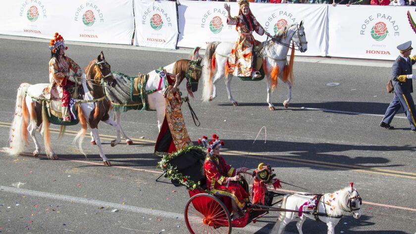 Members of Scripps Miramar Saddlebreds perform along Orange Grove Boulevard during the 125th Tournam