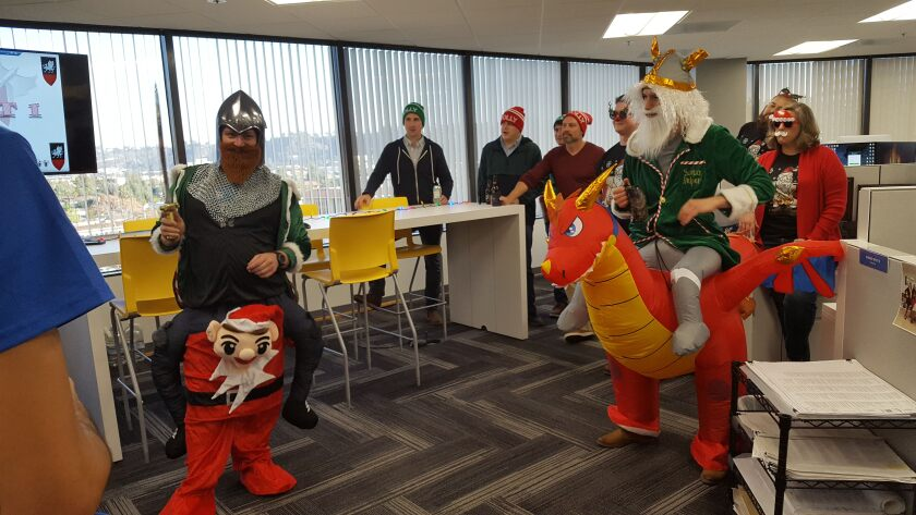 Coffman Engineers employees dressing up for a holiday party.