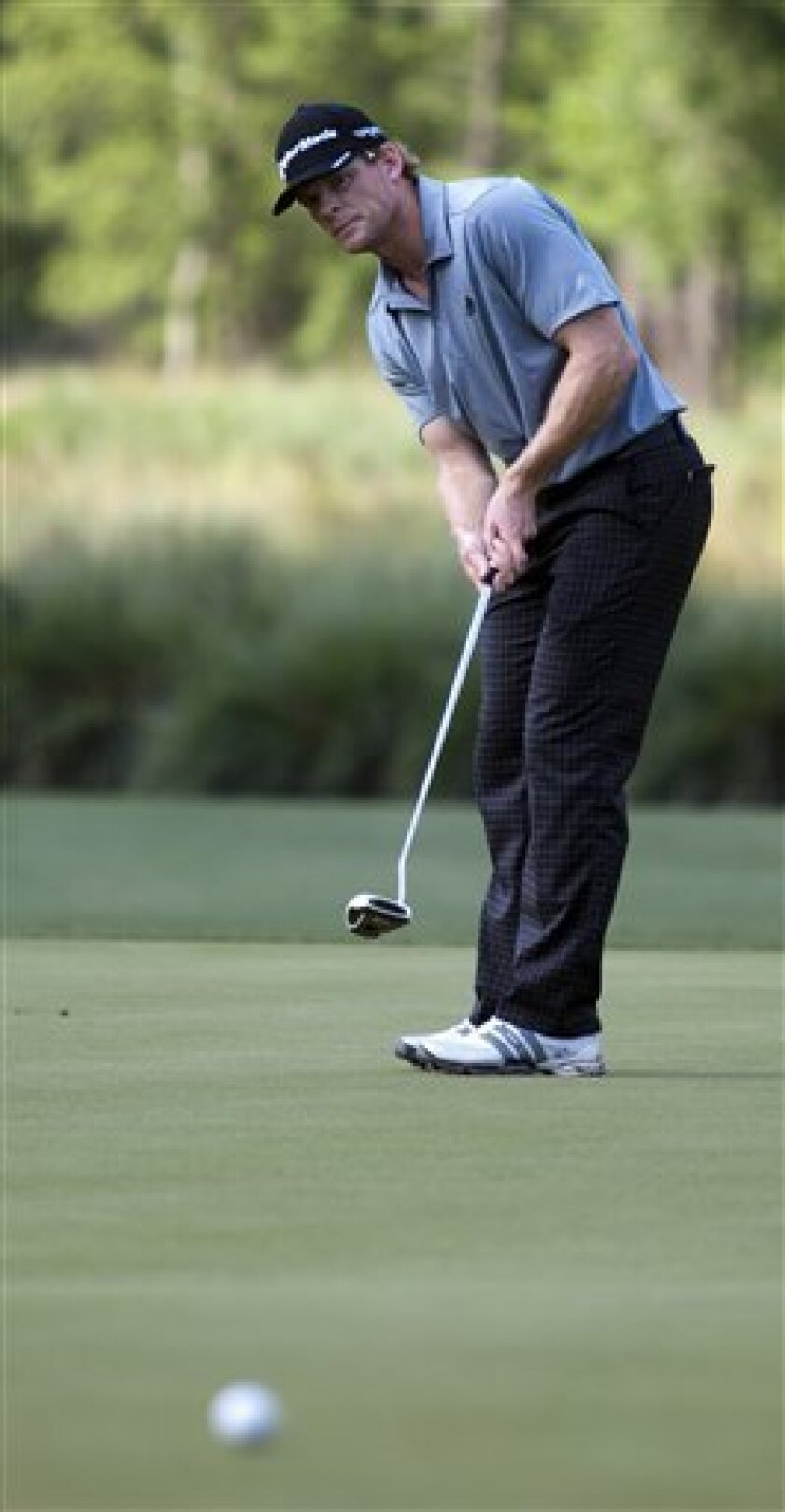 James Driscoll putts on the ninth green during the second round of the Houston Open golf tournament, Saturday, March 31, 2012, in Humble, Texas. (AP Photo/Eric Kayne)