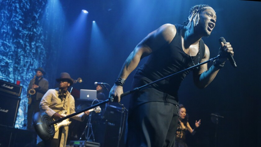 Soul singer D'Angelo peforms at a sold-out Club Nokia on Monday.