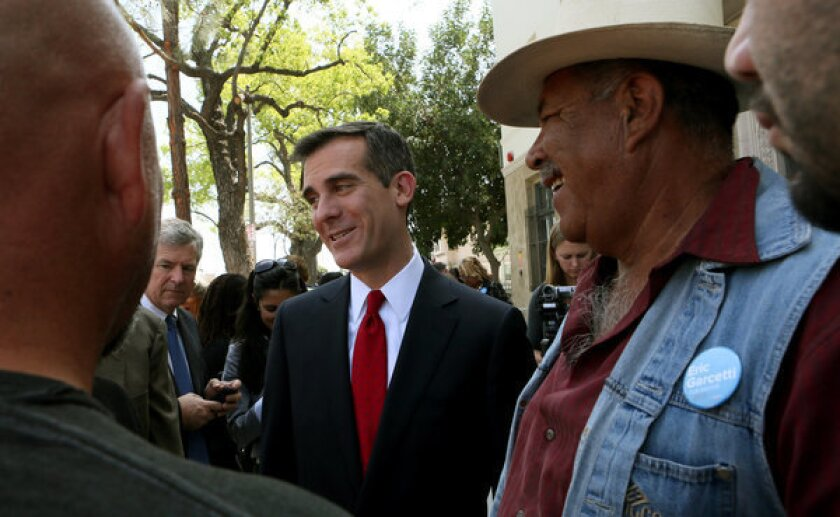 Garcetti amends filings to report ownership interest in property