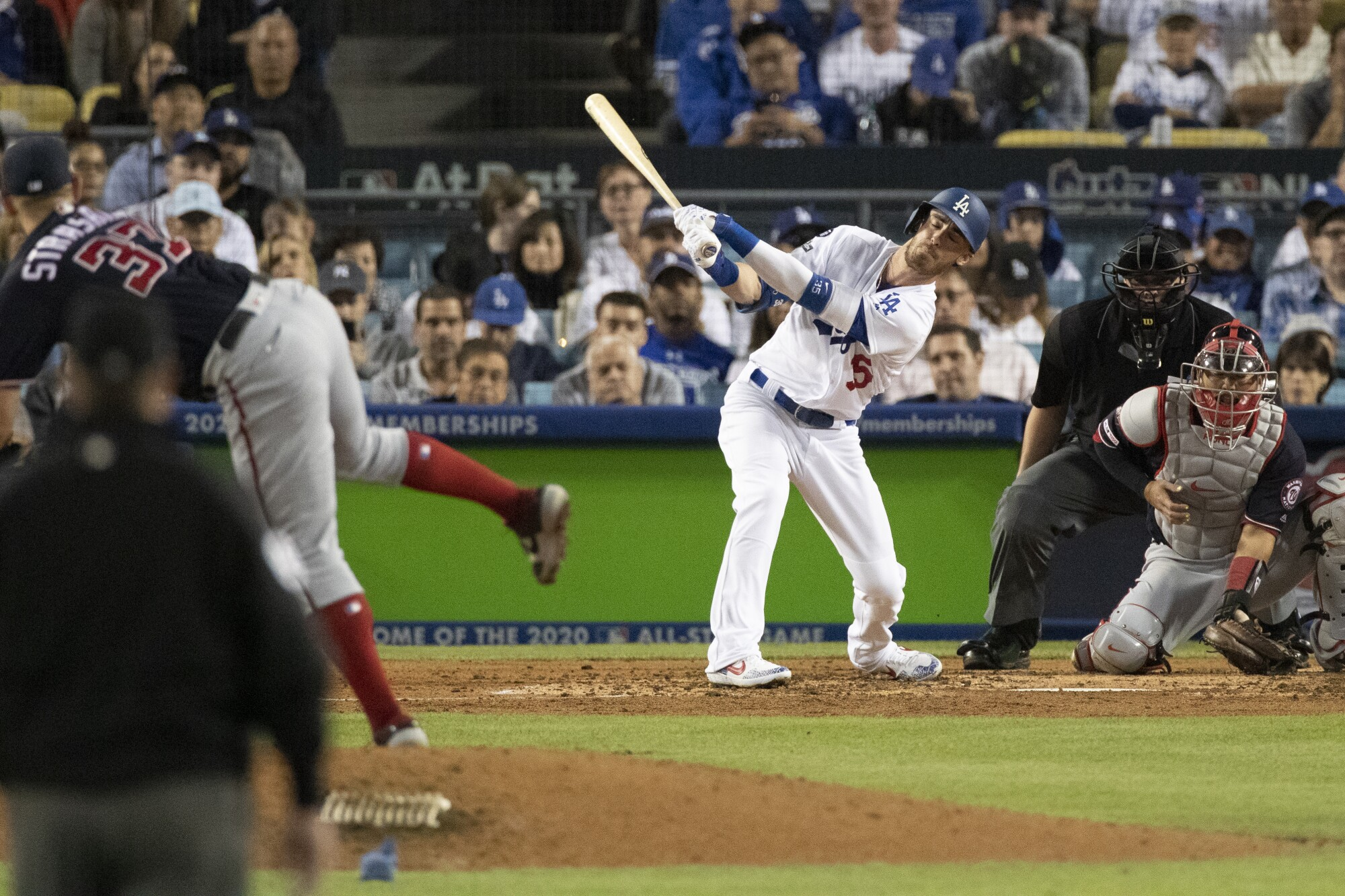 Washington Nationals starting pitcher Stephen Strasburg strikes out Dodgers center fielder Cody Bellinger during the fifth inning of the Dodgers' NLDS Game 2 loss Friday.