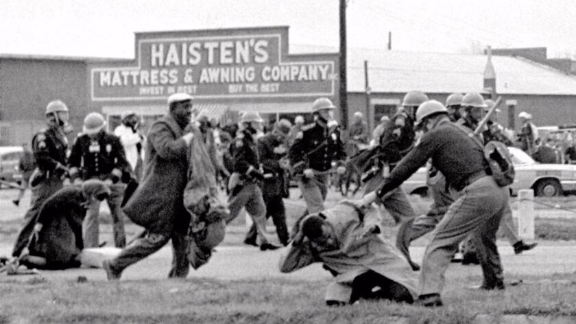 John Lewis, front right, at the hands of an Alabama state trooper on March 7, 1965.