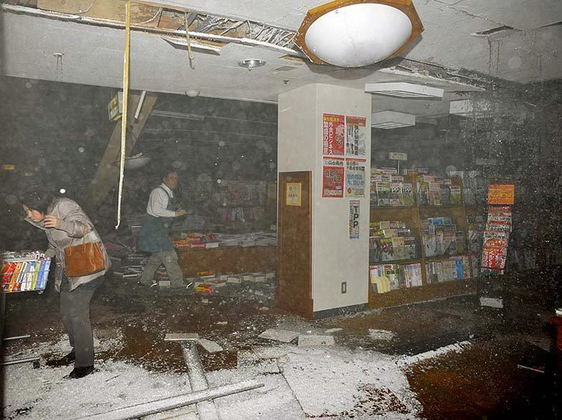 Customers in a bookstore take cover as the earthquake hits March 11 in Sendai, Japan.