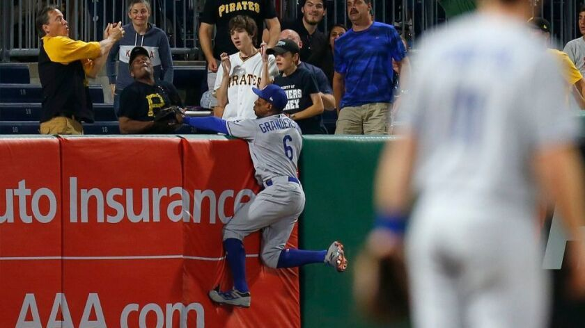 Dodgers outfielder Curtis Granderson leapt into the left-field stands chasing Josh Harrison's game-w