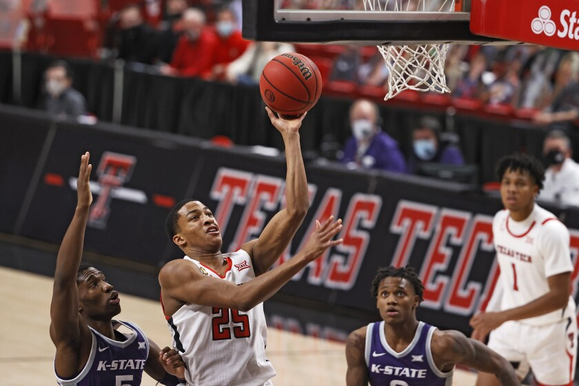 Texas Tech's Nimari Burnett (25) lays up the shot during the second half of an NCAA college basketball game against Kansas State, Tuesday, Jan. 5, 2021, in Lubbock, Texas. (AP Photo/Brad Tollefson)