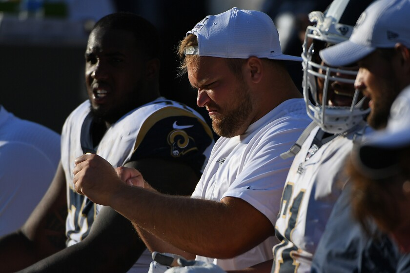 Rams offensive lineman Brian Allen sits on the bench during a preseason game against the Oakland Raiders on Aug. 10.