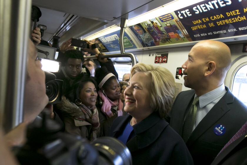 Democratic presidential candidate Hillary Clinton and Bronx Borough President Ruben Diaz Jr. ride the subway in the Bronx as she campaigns in New York.