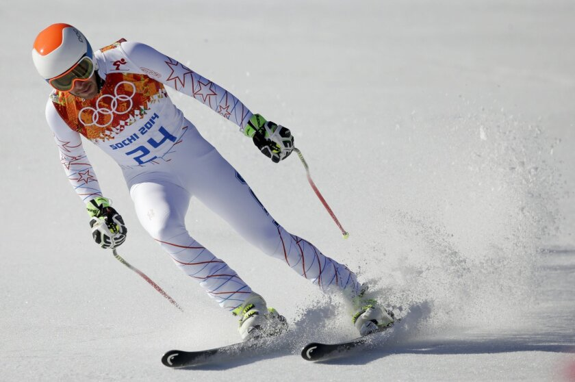 United States' Bode Miller comes to a halt at the end of the downhill portion of the men's supercombined at the Sochi 2014 Winter Olympics, Friday, Feb. 14, 2014, in Krasnaya Polyana, Russia. (AP Photo/Gero Breloer)