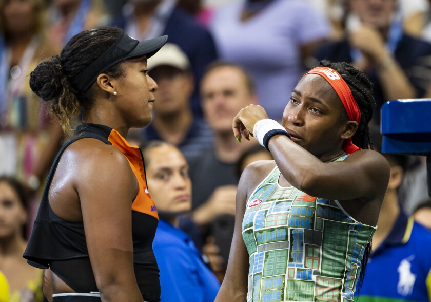 A tearful Coco Gauff, right, is consoled by Naomi Osaka after Osaka's 6-3, 6-0 victory Aug. 31.