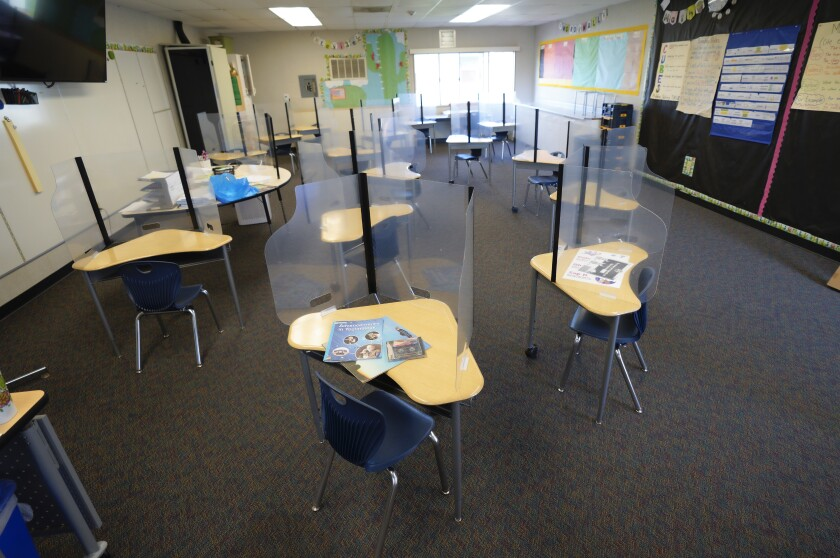 At Vista Square Elementary in Chula Vista, some classroom desks were surrounded by plastic dividers before schools reopened