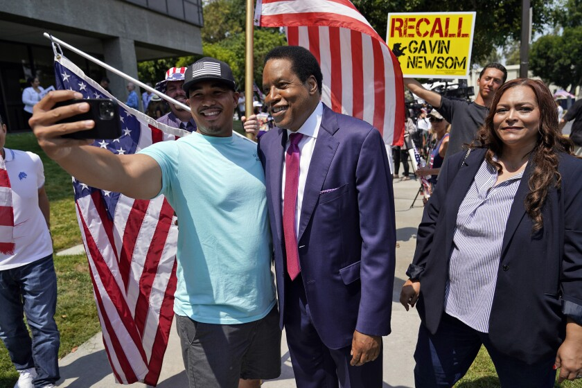 California gubernatorial candidate Larry Elder poses for photos with supporters during a campaign stop in Norwalk.