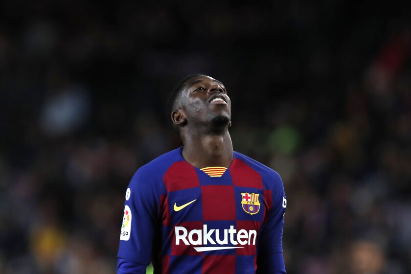 FILE - In this Nov. 9, 2019 file photo, Barcelona's Ousmane Dembele reacts during Spanish La Liga soccer match between Barcelona and Celta at the Camp Nou stadium in Barcelona. More than 17,000 fans were at the Camp Nou when Ousmane Dembele was officially introduced by Barcelona in 2017. The expectations were high at the time. Two and a half seasons later, though, Barcelona fans are still waiting for Dembele to meet all those expectations that came along with his signing. (AP Photo/Joan Monfort, File)