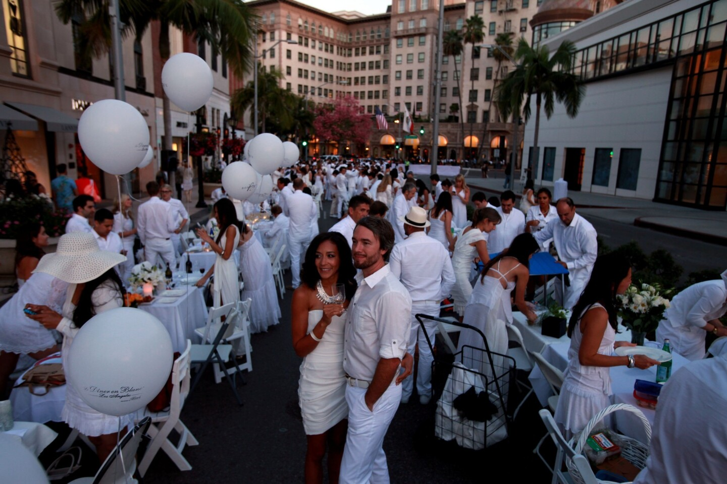A 1,000-person dinner party took place Wednesday night on Rodeo Drive in Beverly Hills. Attendees brought their own food, chairs, tables and linens and dressed in white for the feast. The event was started by a French couple, and this is the first time it has taken place in Southern California.