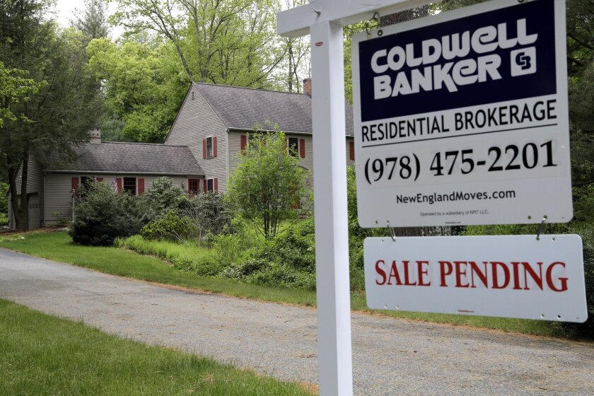 """This Tuesday, May 24, 2016, photo shows a """"Sale Pending"""" sign in front of a house in North Andover, Mass. On Thursday, May 26, 2016, the National Association of Realtors releases its April report on pending home sales, which are seen as a barometer of future purchases. (AP Photo/Elise Amendola)"""