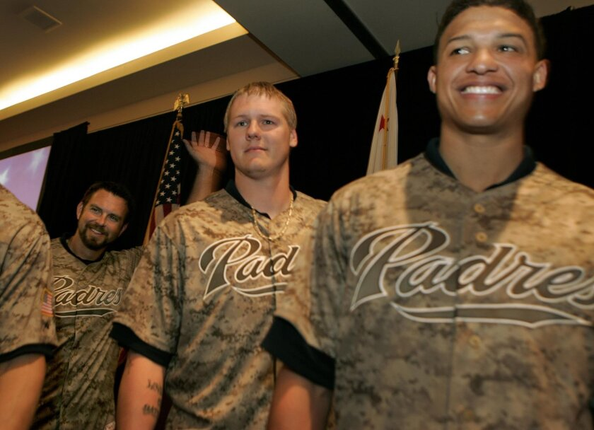 From left, Heath Bell, Mat Latos and Will Venable show off Padres' new camouflage jerseys.