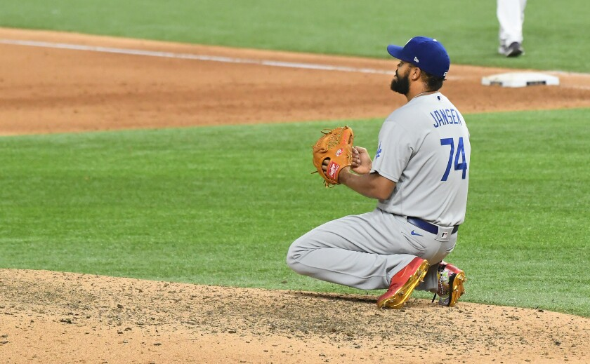The Dodgers' Kenley Jansen drops to his knees after giving up a walk-off single in Game 4 of the World Series.