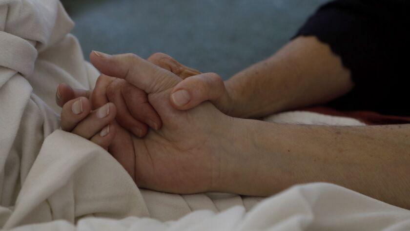 Santa Barbara, CA JUNE 8, 2018: Donna Williams holds her husband Ken Williams, 67, hand in Santa
