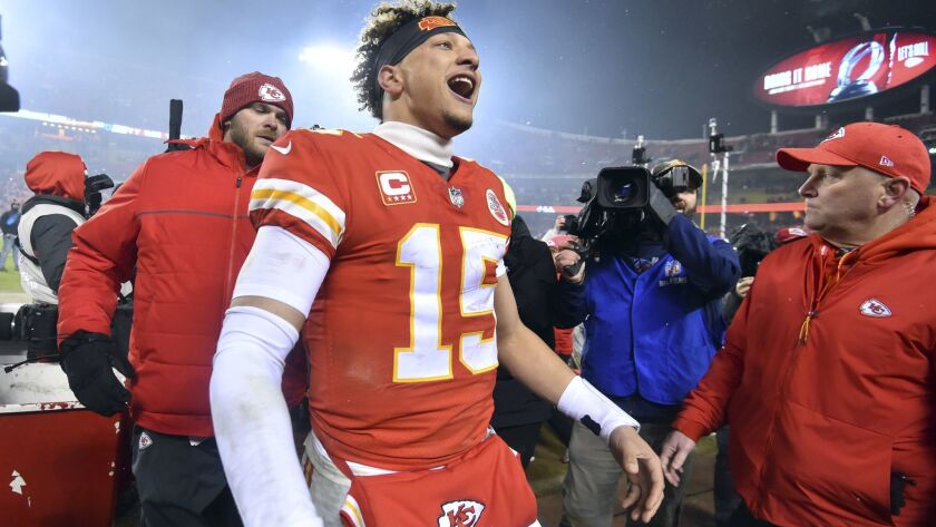 Kansas City Chiefs quarterback Patrick Mahomes (15) interacts with fans following an NFL divisional