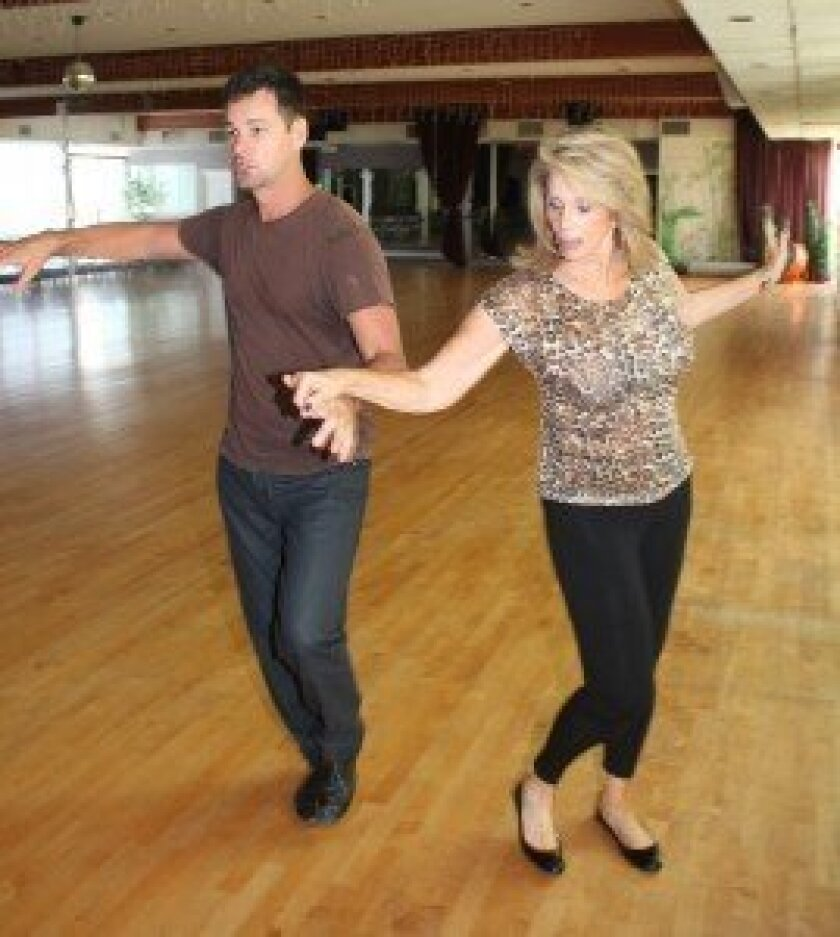 La Jolla Realtor Maxine Gellens and her dance instructor and partner, Dan Gibbons, rehearse Sept. 6 for La Jolla Dancing with the Stars at Mary Murphy's Champion Ballroom Academy in Hillcrest. Pat Sherman