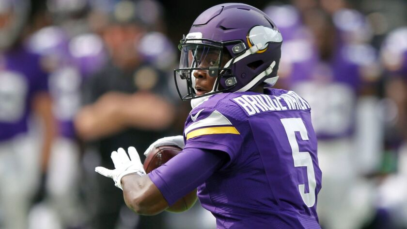 FILE - In this Aug. 28, 2016, file photo, Minnesota Vikings quarterback Teddy Bridgewater throws a p