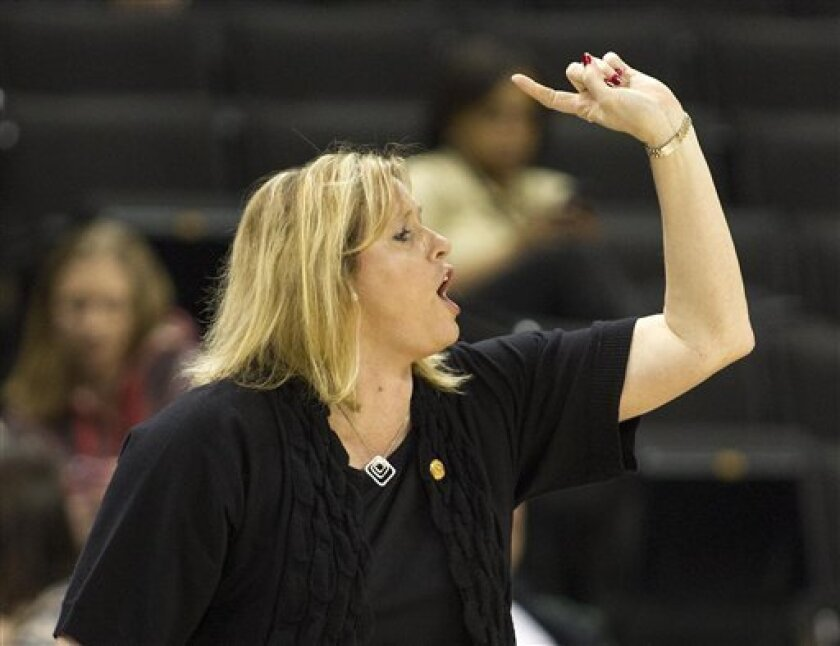 Wake Forest coach Jen Hover directs her team against Maryland during the first half of an NCAA college basketball game in Winston-Salem, N.C., Friday, Feb. 8, 2013. Maryland won 73-63. (AP Photo/Lynn Hey)