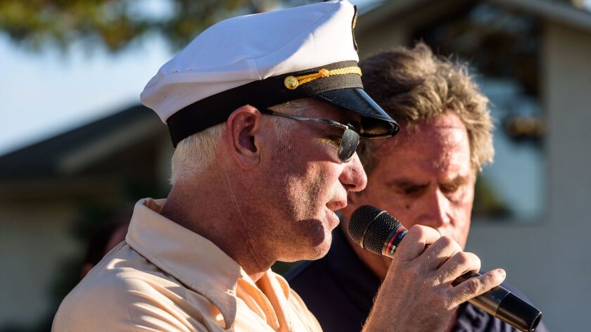 Ernie Hahn addresses golfers at the CaddyHack Golf Tournament benefiting Boys 2 Men Mentoring at Mor