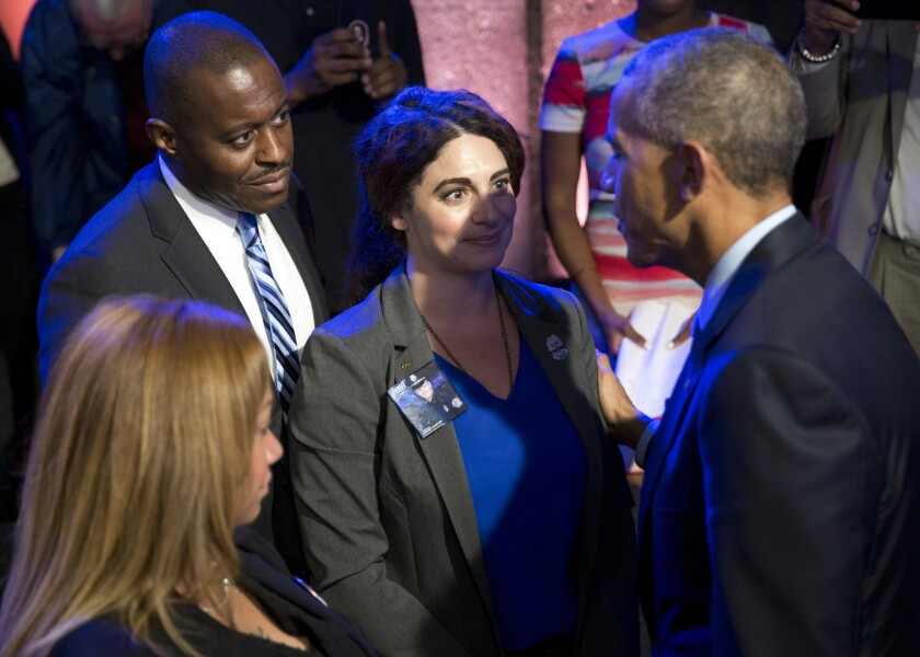 President Barack Obama greets people in the audience after participating in a town hall with ABC news anchor David Muir, officers, parents, students, community leaders and families on July 14, 2016, in Washington.