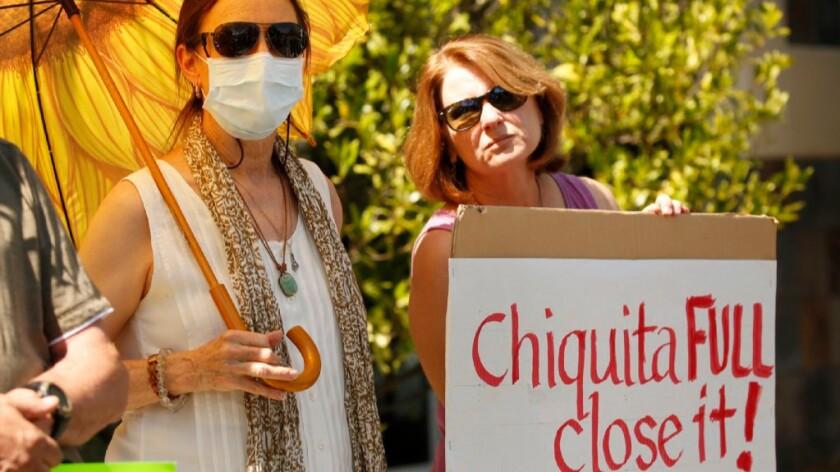 Protesters outside Supervisor Michael Antonovich's office in Santa Clarita call for the closure of the Chiquita Canyon Landfill.