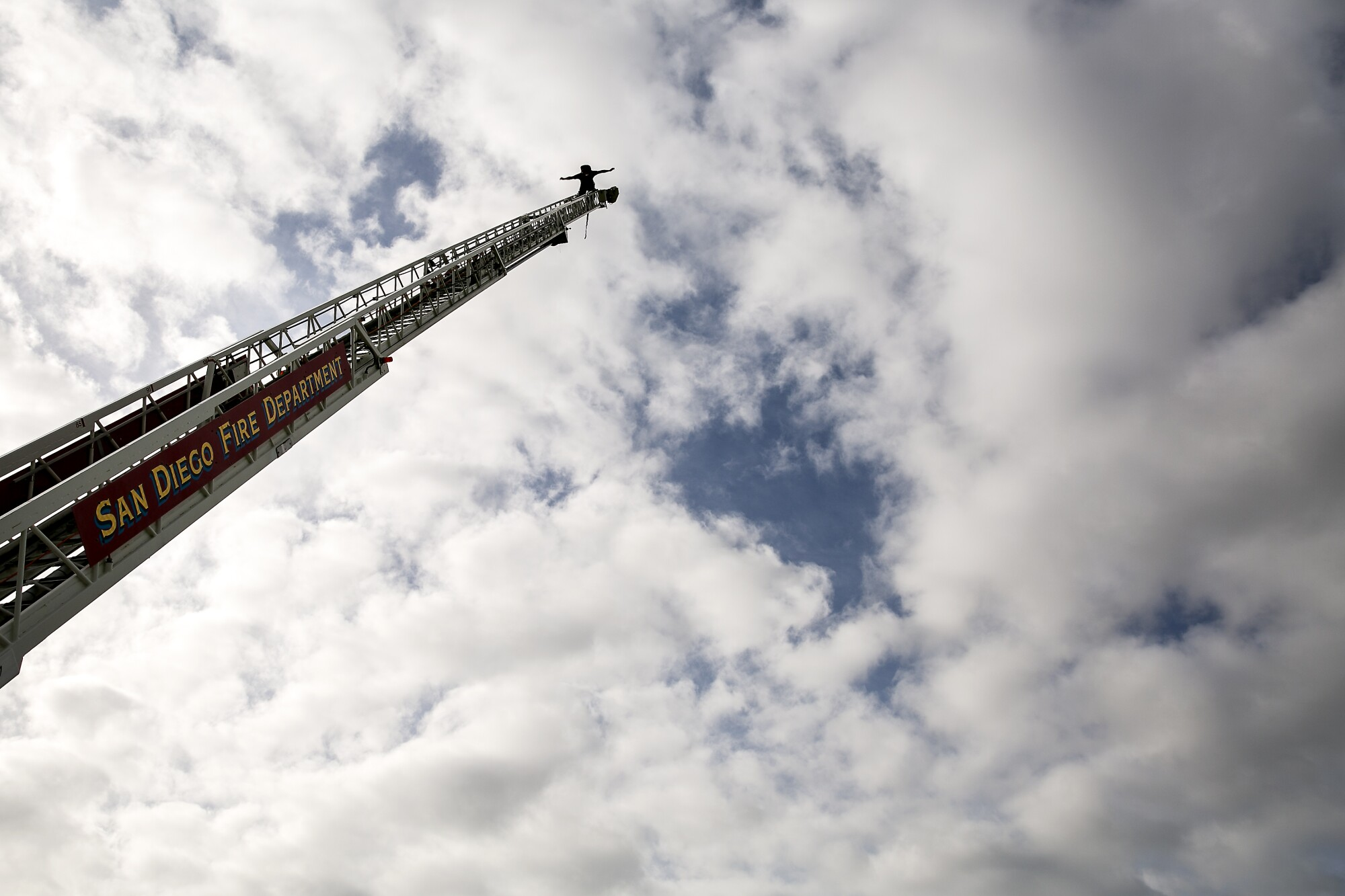 """Recruits in the San Diego Fire-Rescue Department's 87th academy must scale a 105-foot ladder that's set at a 60-degree angle on the back of a fire truck. When they reach the top, they have to lean back -- """"trust your equipment,"""" an instructor tells them repeatedly -- and shout their academy's motto: """"With Pride We Fight!"""""""