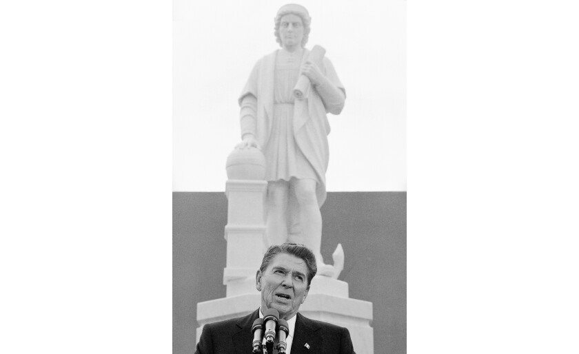 President Reagan speaks at a ceremony in Baltimore to unveil a statue of Christopher Columbus in 1984