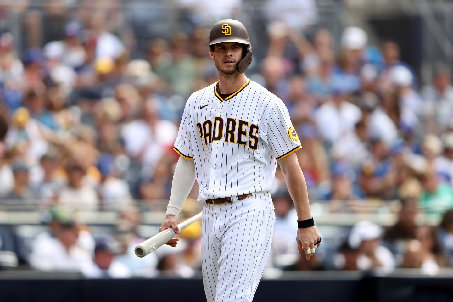 SAN DIEGO, CALIFORNIA - JUNE 09: Wil Myers #5 of the San Diego Padres looks on after striking out during a game against the Chicago Cubs at PETCO Park on June 09, 2021 in San Diego, California. (Photo by Sean M. Haffey/Getty Images)