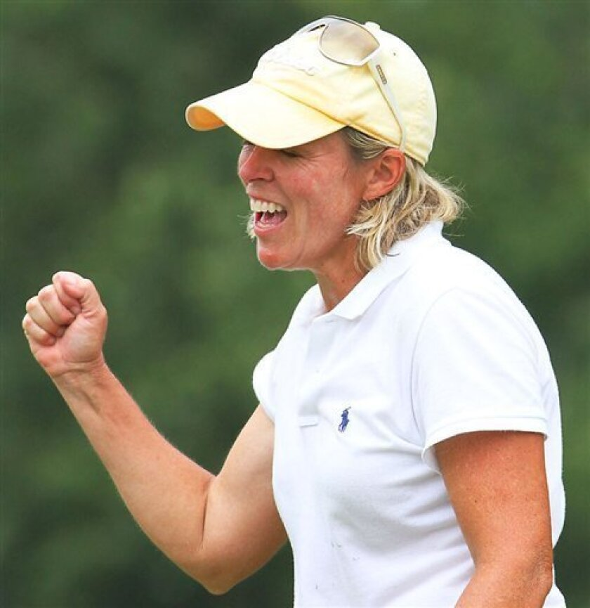 Martha Leach of Hebron, Ky., pumps her fist after winning the final round of match play on the 16th hole at the Women's Mid-Amateur Championship golf tournament in Golden Hills Golf and Turf Clubin Ocala, Fla., Thursday, Oct. 8, 2009. (AP Photo/Ocala Star-Banner, Bruce Ackerman)