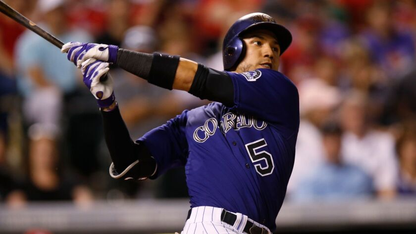 Colorado Rockies right fielder Carlos Gonzalez pops out against the St. Louis Cardinals in the seventh inning of a baseball game Monday, June 8, 2015, in Denver.
