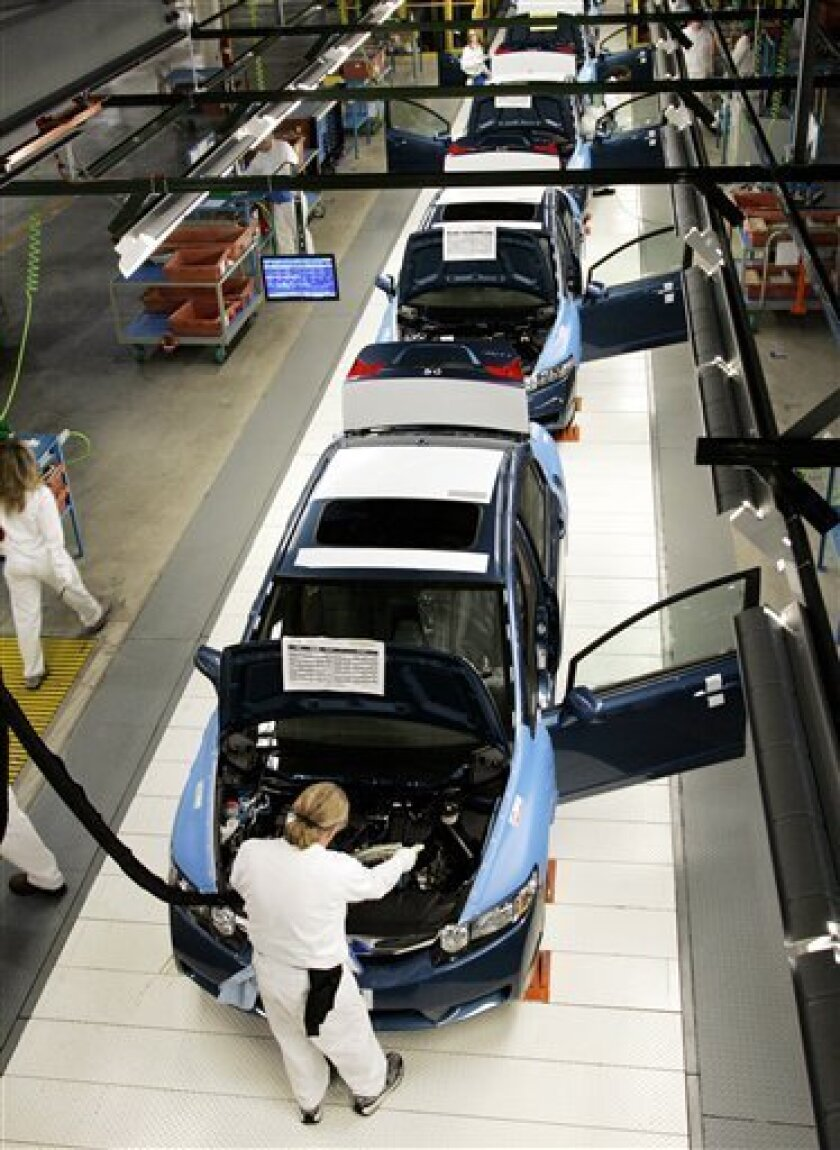 Honda Civics are assembled along the line at the Honda assembly plant in Greensburg, Ind., Monday, Nov. 17, 2008. The plant began producing the Honda Civic Sedan in October.  Honda's U.S. division on Tuesday, Dec. 2 said its sales plunged 31.6 percent as the tepid economic environment continued to